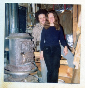 Maine, 1974. Julie & Richie cozying up to the wood stove on their organic farm.